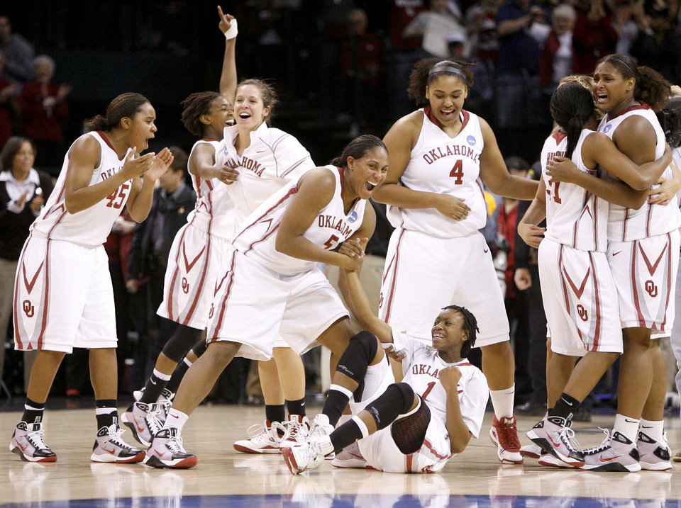 Photo - The OU team celebrates after their win in the NCAA women's basketball regional  tournament finals between Oklahoma and Purdue at the Ford Center in Oklahoma City, Tuesday, March 31, 2009. OU won, 74-68. Photo by Bryan Terry, The Oklahoman