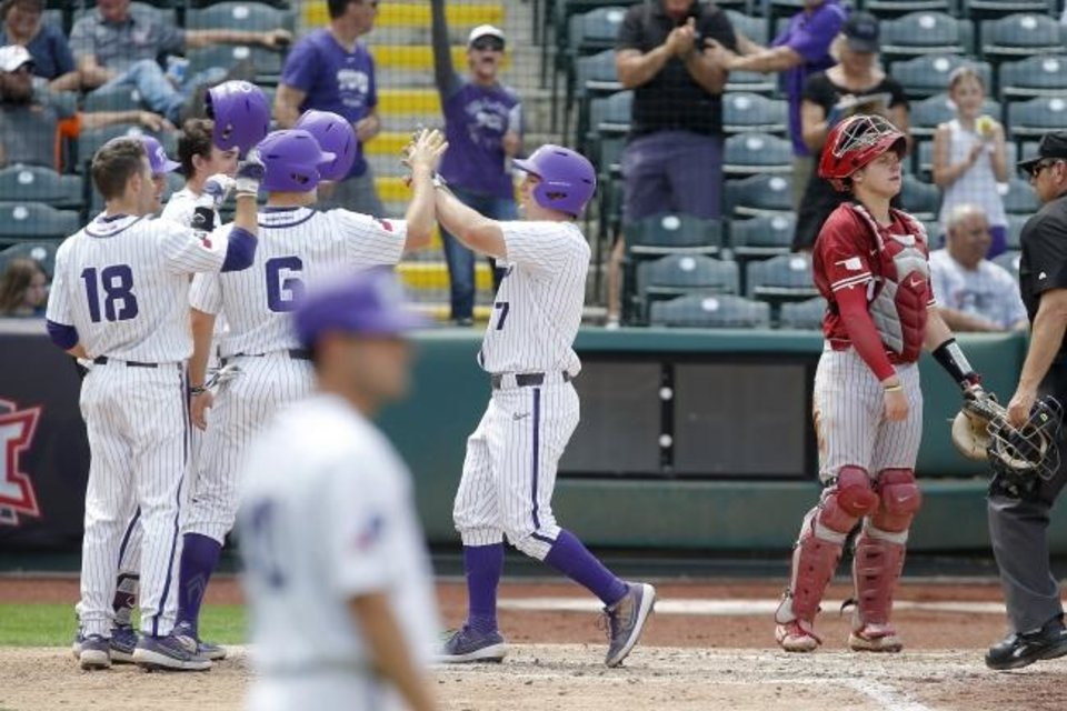Photo -  TCU's Josh Watson (7) celebrates beside Oklahoma catcher Brady Lindsly after hitting a grand slam in the fourth inning of a 15-3 win against the Sooners in a Big 12 Tournament elimination game Thursday at Bricktown Ballpark.  [Bryan Terry/The Oklahoman]