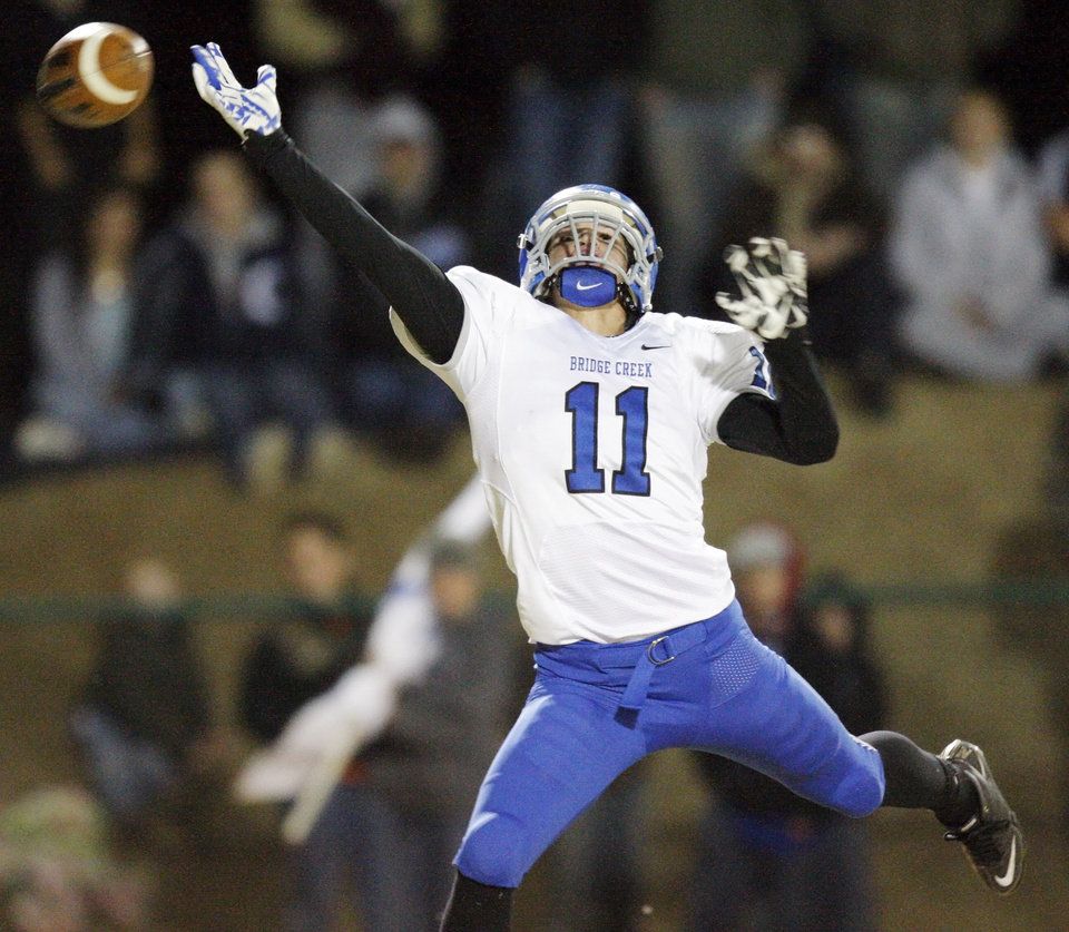 Bridge Creek\'s Caden Locke (11) tries to intercept a Heritage Hall pass during the high school football playoff game between Bridge Creek and Heritage Hall at Heritage Hall School in Oklahoma City, Friday, Nov. 19, 2010. The pass was incomplete. Photo by Nate Billings, The Oklahoman