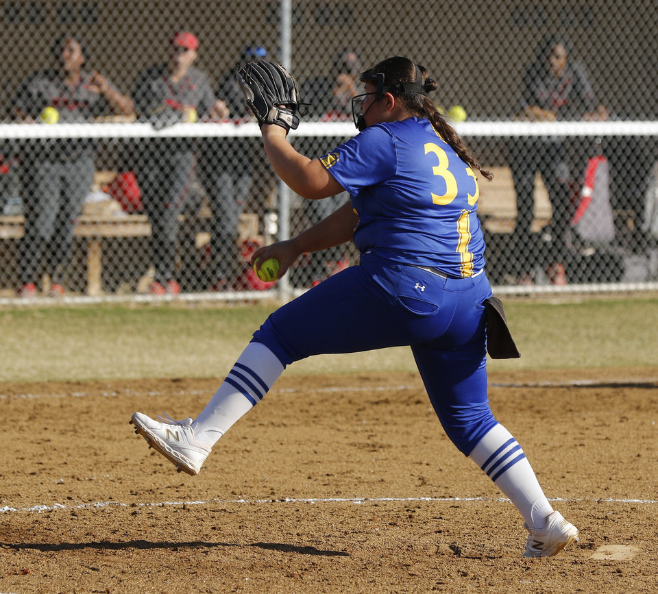 Photo - PHS #33 Chloe Bohuslavicky pitching in the 8th during the 5A Fast Pitch Championship game between Piedmont and Carl Albert at the Ball Fields at Firelake in Shawnee, Saturday, October 19, 2019. [Doug Hoke/The Oklahoman]