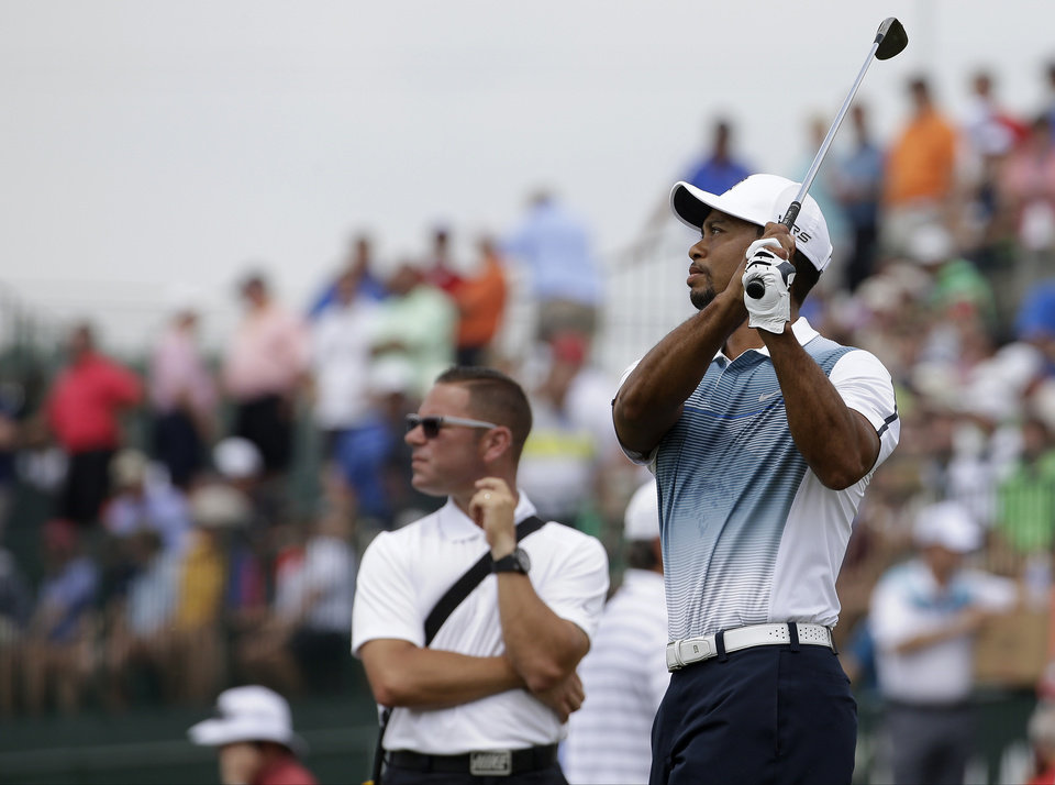 Photo - Tiger Woods warms up on the driving range before a practice round for the PGA Championship golf tournament at Valhalla Golf Club on Wednesday, Aug. 6, 2014, in Louisville, Ky. The tournament is set to begin on Thursday. (AP Photo/David J. Phillip)