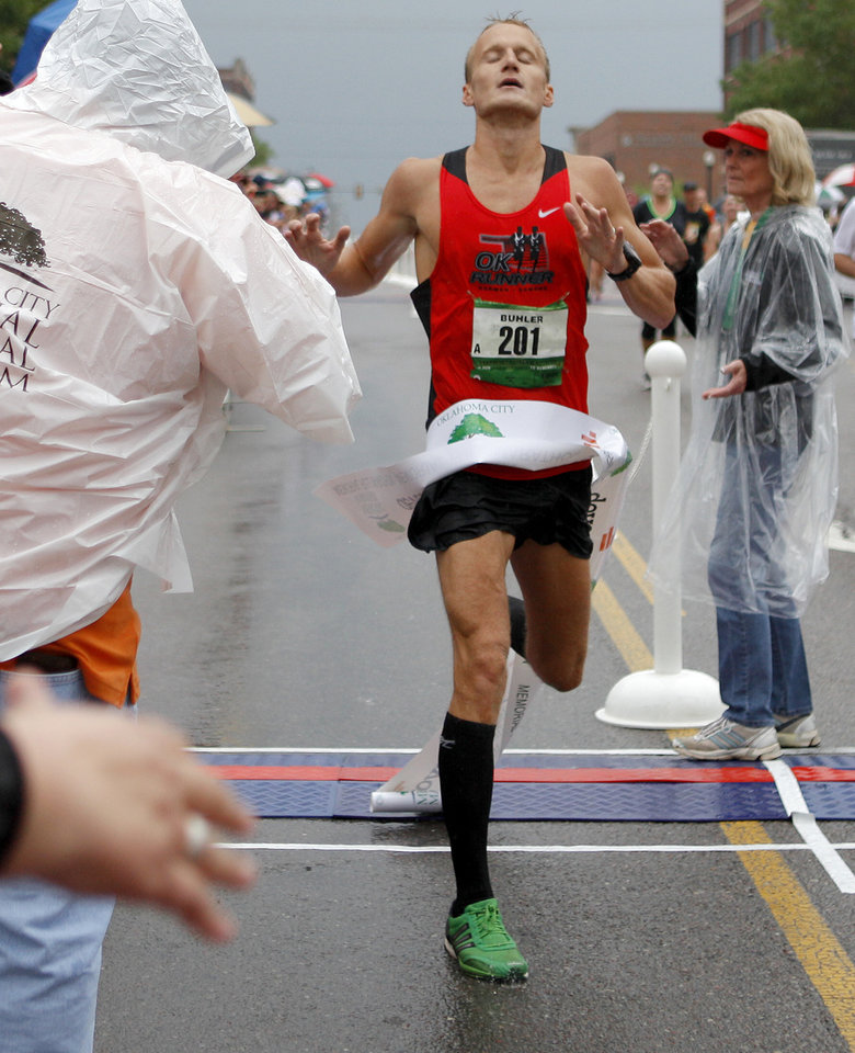 Photo - RUN / RUNNERS / RUNNING: WINNER: Jake Buhler of Edmond wins the the Oklahoma City Memorial Marathon in Oklahoma City, Sunday, April 29, 2012. Photo by Bryan Terry, The Oklahoman