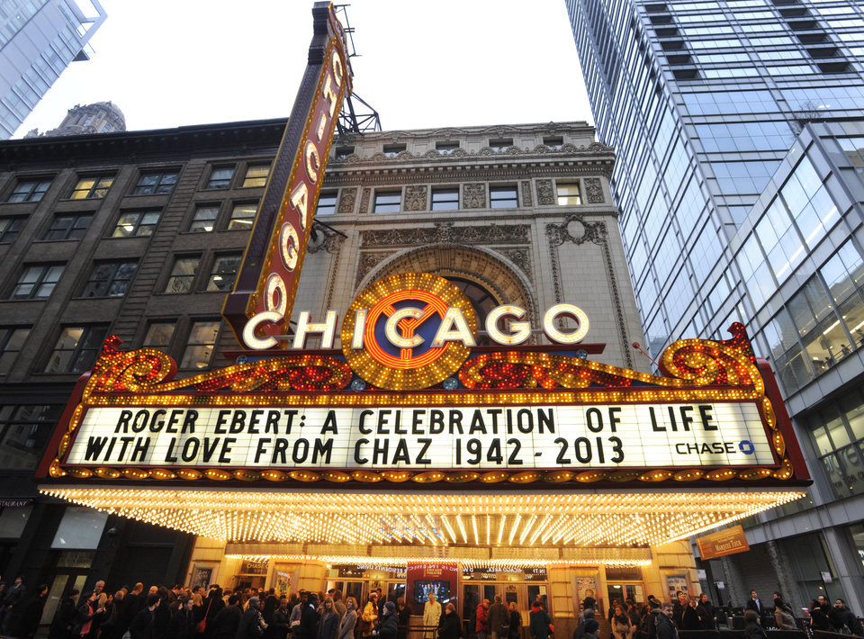 Photo - The Chicago Theater marquee before a memorial for film critic Roger Ebert in Chicago, Thursday, April 11, 2013. The Pulitzer Prize winning critic died last week at the age of 70 after a long battle with cancer. (AP Photo/Paul Beaty)