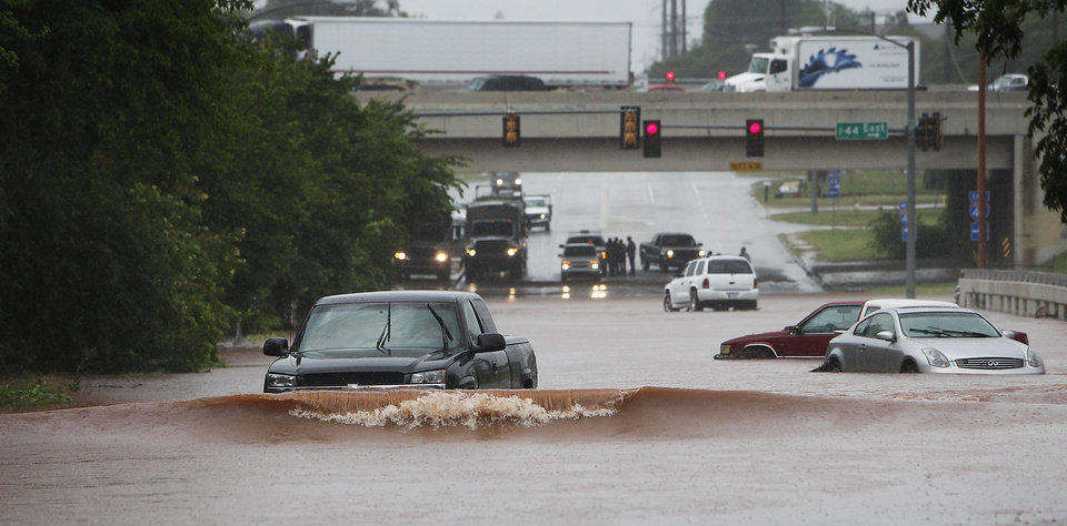 A truck make a wave as it drives through high water on Kelley just south of I-44, Monday,  June 14, 2010.    Photo by David McDaniel, The Oklahoman