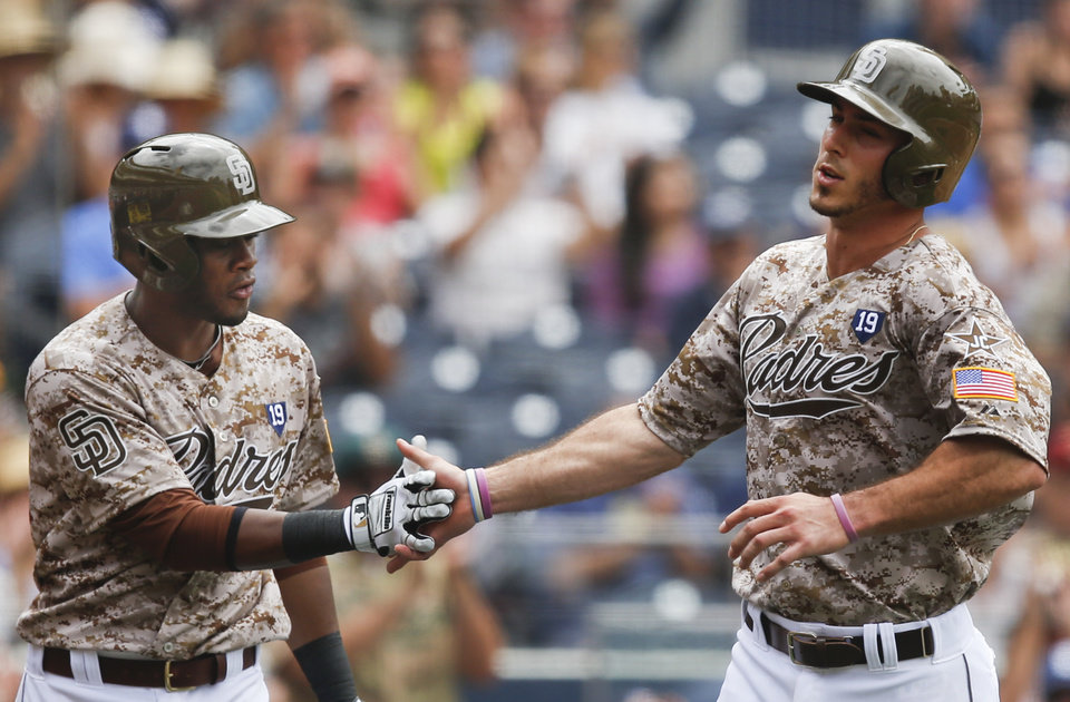 San Diego Padres\' Tommy Medica, right, is congratulated by Irving Falu after scoring against the Arizona Diamondbacks on a sacrifice fly by Alexi Amarista during the fourth inning of a baseball game Sunday, June 29, 2014, in San Diego. (AP Photo/Lenny Ignelzi)