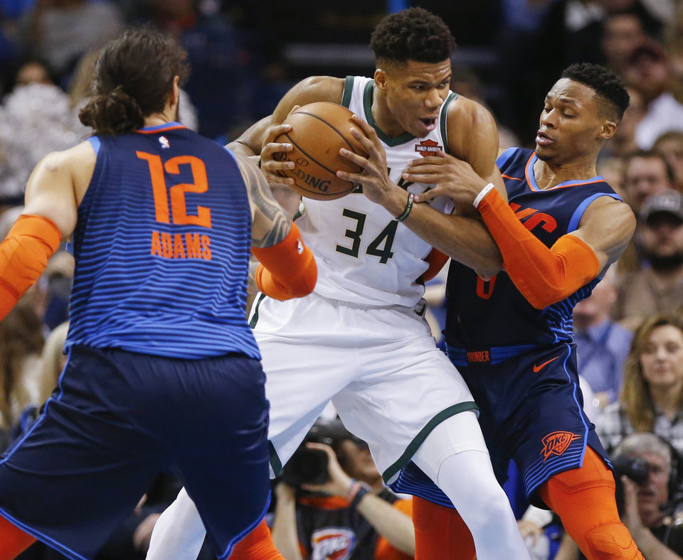 Photo - Oklahoma City's Russell Westbrook (0) and Steven Adams (12) defend Milwaukee's Giannis Antetokounmpo (34) in the fourth quarter during an NBA basketball game between the Milwaukee Bucks and the Oklahoma City Thunder at Chesapeake Energy Arena in Oklahoma City, Sunday, Jan. 27, 2019. Oklahoma City won 118-112. Photo by Nate Billings, The Oklahoman