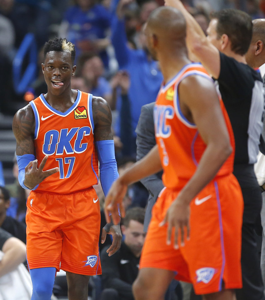 Photo - Oklahoma City's Dennis Schroder (17) celebrates after a Chis Paul  basket during an NBA basketball game between the Oklahoma City Thunder and the LA Clippers at Chesapeake Energy Arena in Oklahoma City, Sunday, Dec. 22, 2019. Oklahoma City won 118-112. [Bryan Terry/The Oklahoman]