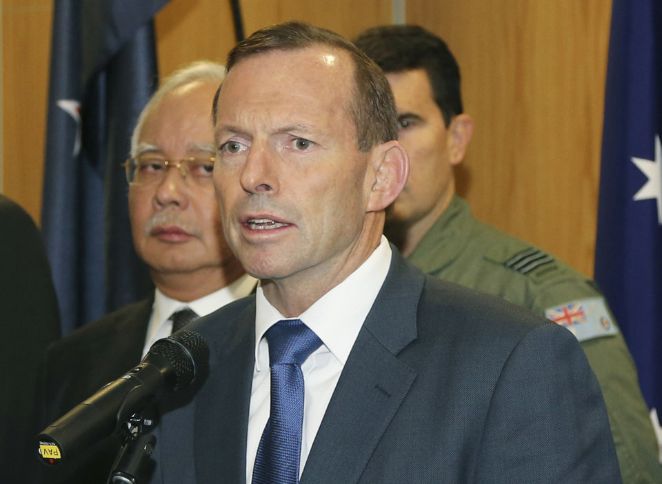 Photo - FILE - In this Thursday, April 3, 2014 file photo, Australian Prime Minister Tony Abbott speaks as Malaysia Prime Minister Najib Razak, left, looks on during a breakfast with crew members from different countries involved in the search for wreckage and debris of the missing Malaysia Airlines Flight 370 in Perth, Australia. Abbott said in Shanghai, China, Friday, April 11, that authorities are confident that a series of underwater signals detected in a remote patch of the Indian Ocean are coming from the missing Malaysia Airlines plane. (AP Photo/Rob Griffith, Pool, File)
