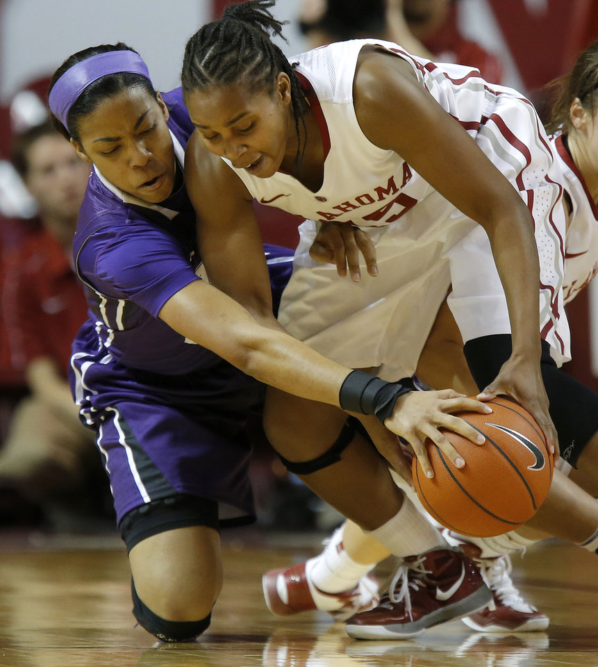 Oklahoma's Jasmine Hartman (45) and TCU's Donielle Breaux (33) fight for control of the ball during a women's college basketball game between the University of Oklahoma and TCU at the Llyod Noble Center in Norman, Okla., Wednesday, Jan. 30, 2013. Oklahoma won 74-53. Photo by Bryan Terry, The Oklahoman