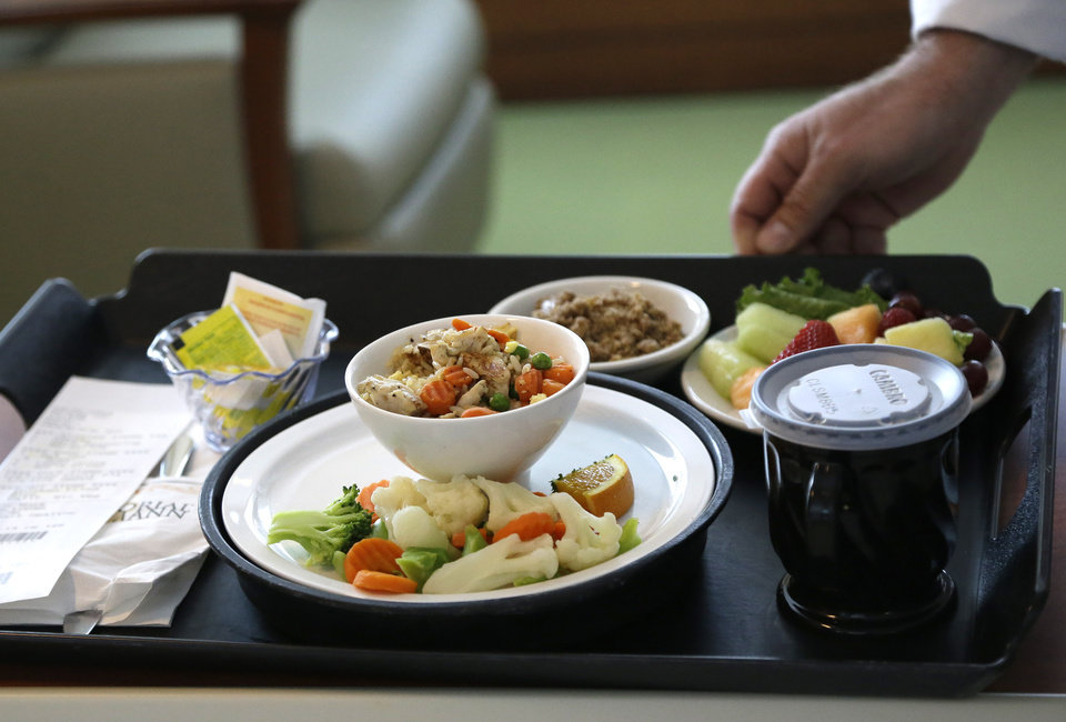 Photo - A heart healthy lunch of chicken fried rice, vegetables, fruit and dessert is served to a heart patient Thursday, May 1, 2014, at Houston's Memorial Hermann Southwest Hospital. Menu changes are one way to care for an increasingly diverse population that hails from regions once not typical to the Houston area. (AP Photo/Pat Sullivan)