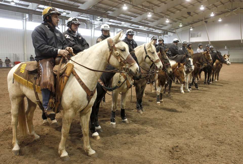 Riders and their horses line up in formation during an annual training event to qualify deputies and horses for the Oklahoma County Sheriff\'s Office Mounted Patrol Division at State Fair Park in Oklahoma City, OK, Saturday, March 5, 2011. By Paul Hellstern, The Oklahoman ORG XMIT: KOD