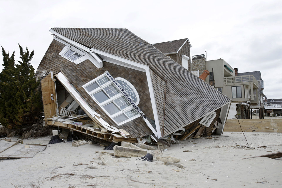 A home is smashed off its foundation near the Atlantic Ocean in Brick Township, N.J., Friday, Feb. 22, 2013, one of many homes lefty badly damaged by Superstorm Sandy. (AP Photo/Mel Evans)