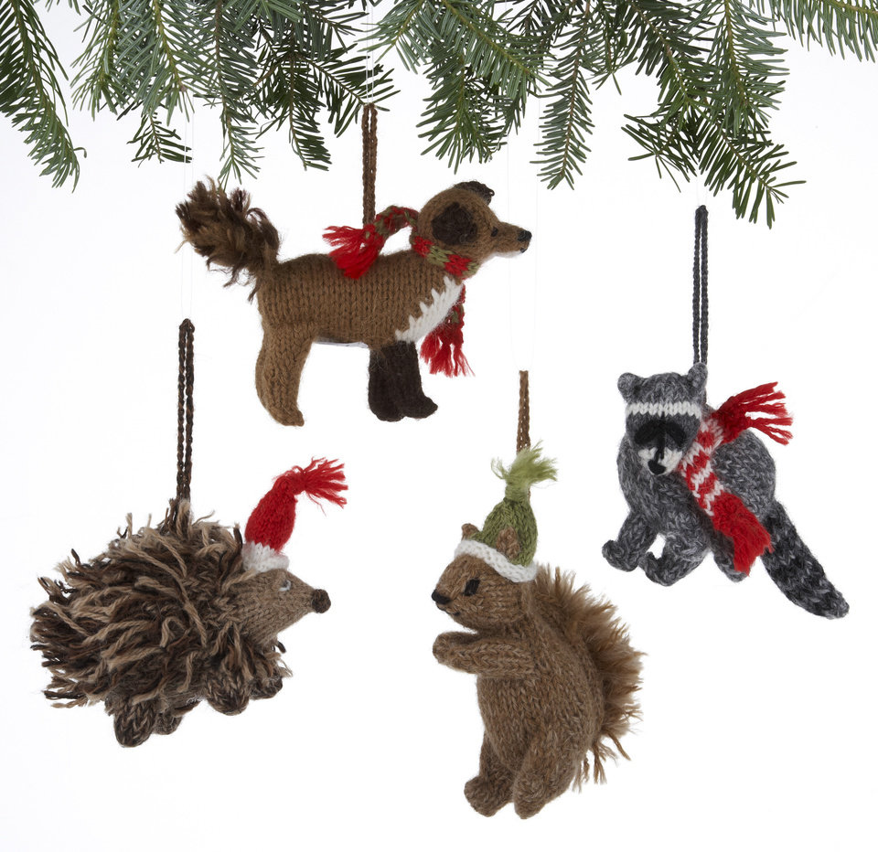 In this undated publicity image provided by Crate and Barrel, Alpaca Woodland Creatures ornaments made of soft alpaca blend wool by rural Peruvian women are shown. Crate and Barrel collaborated on the collection with a fair trade group that helps the women earn money to support and sustain their families. (AP Photo/Crate and Barrel)