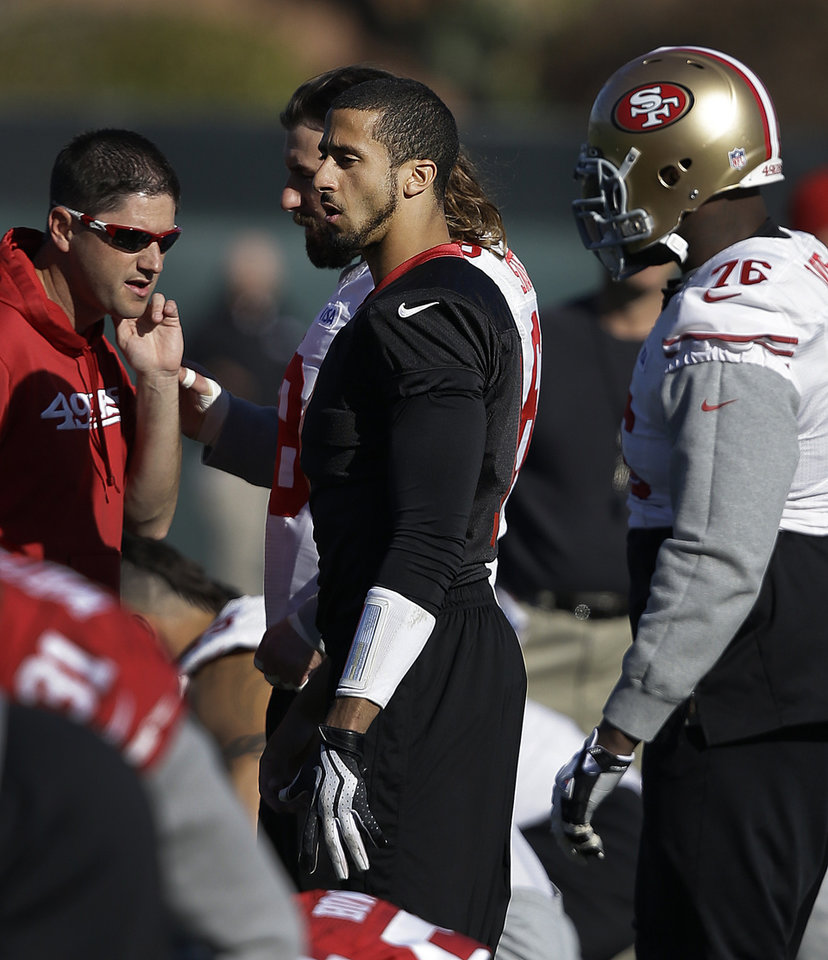 Photo - San Francisco 49ers quarterback Colin Kaepernick, center, prepares for an NFL football practice in Santa Clara, Calif., Friday, Jan. 17, 2014. The 49ers are scheduled to play the Seattle Seahawks for the NFC championship on Sunday. (AP Photo/Ben Margot)