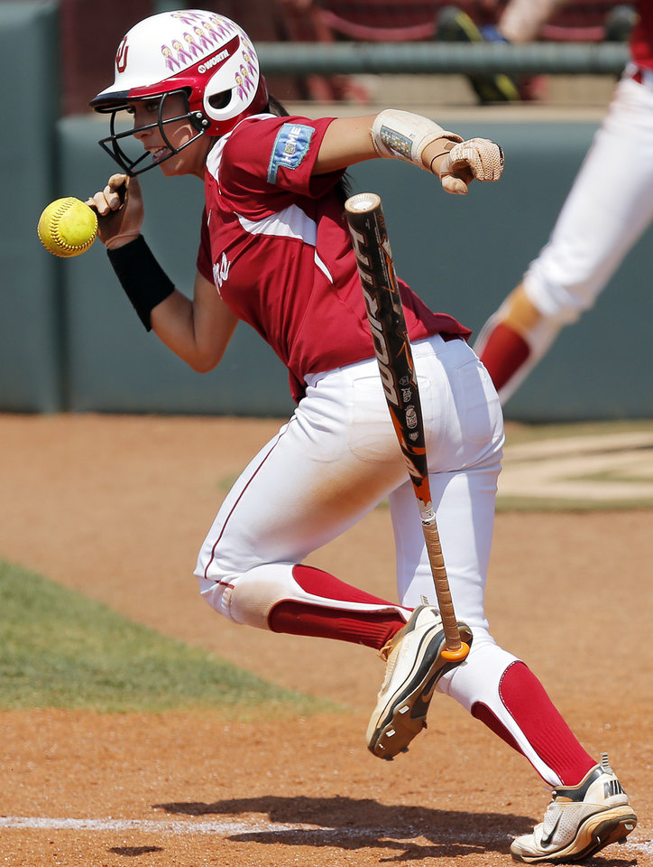OU's Destinee Martinez (00) gets a hit in the 7th inning during the final game of the Norman Regional in 2014 NCAA softball championship between Oklahoma and Texas A&M in Norman, Okla., Sunday, May 18, 2014. OU won 11-6. Photo by Nate Billings, The Oklahoman