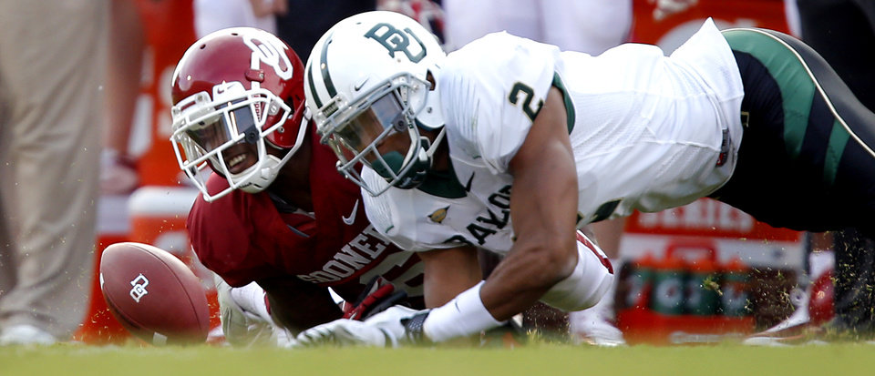 Oklahoma's Demontre Hurst (6) breaks up a pass for Baylor's Terrance Williams (2) during the college football game between the University of Oklahoma Sooners (OU) and Baylor University Bears (BU) at Gaylord Family - Oklahoma Memorial Stadium on Saturday, Nov. 10, 2012, in Norman, Okla.  Photo by Chris Landsberger, The Oklahoman