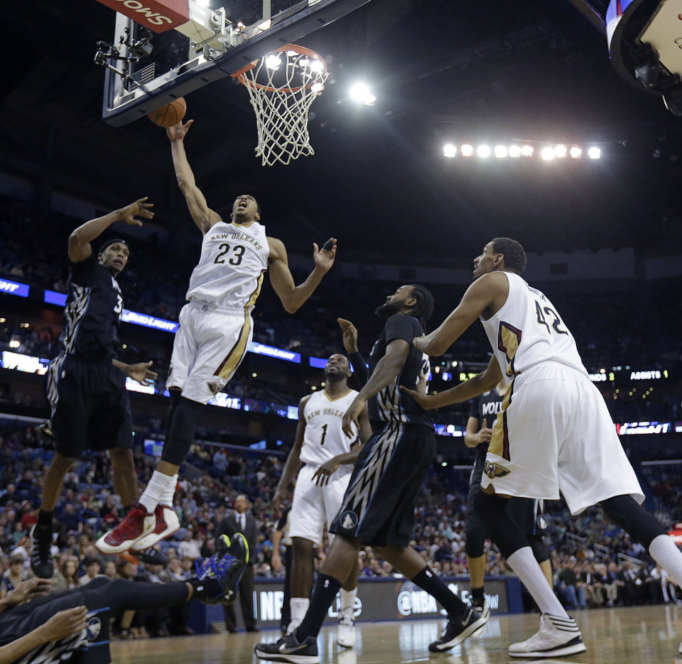 Photo - New Orleans Pelicans power forward Anthony Davis (23) goes to the basket in the first half of an NBA basketball game against the Minnesota Timberwolves in New Orleans, Friday, Feb. 7, 2014. (AP Photo/Gerald Herbert)