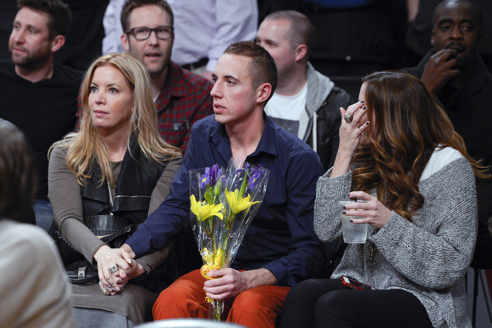 Photo - Los Angeles Lakers executive vice president Jeanie Buss, left, watches with friends and family during a memorial for her late father and team owner Jerry Buss before an NBA basketball game between the Lakers and the Boston Celtics, Wednesday, Feb. 20, 2013, in Los Angeles. Jerry Buss died Monday after a battle with cancer. (AP Photo/Mark J. Terrill)