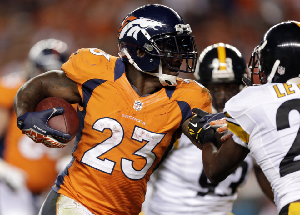 Photo -   FILE - In this Sept. 9, 2012, Denver Broncos running back Willis McGahee runs against the Pittsburgh Steelers during the fourth quarter of an NFL football game in Denver. McGahee's 32 career 100-yard rushing games are more than any active running back in the NFL. Not bad for a guy that many doubted would even make it to the NFL after he tore three ligaments in his left knee in his final college game at Miami a decade ago. (AP Photo/Joe Mahoney, File)