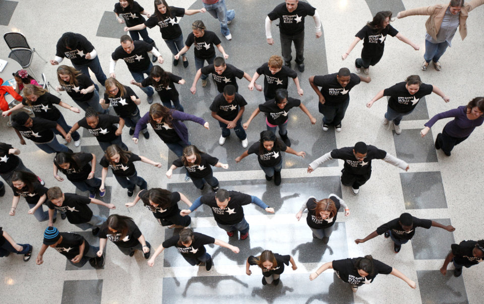 Photo - A flash mob dance routine is performed Feb. 4 by Whiz Kids participants, Carl Albert Middle School students and members of the 2012 Leadership Oklahoma Young Adult Leaders class, at Ronald J. Norick Downtown Library in Oklahoma City. Photo by Sarah Phipps, The Oklahoman