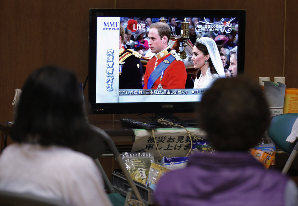 Photo - Evacuees watch the royal wedding by Prince William and Kate Middleton on TV at a shelter for victims of the earthquake and tsunami in Ishinomaki, Miyagi Prefecture, northeastern Japan, Friday, April 29, 2011. (AP Photo/Hiro Komae) ORG XMIT: XHK111