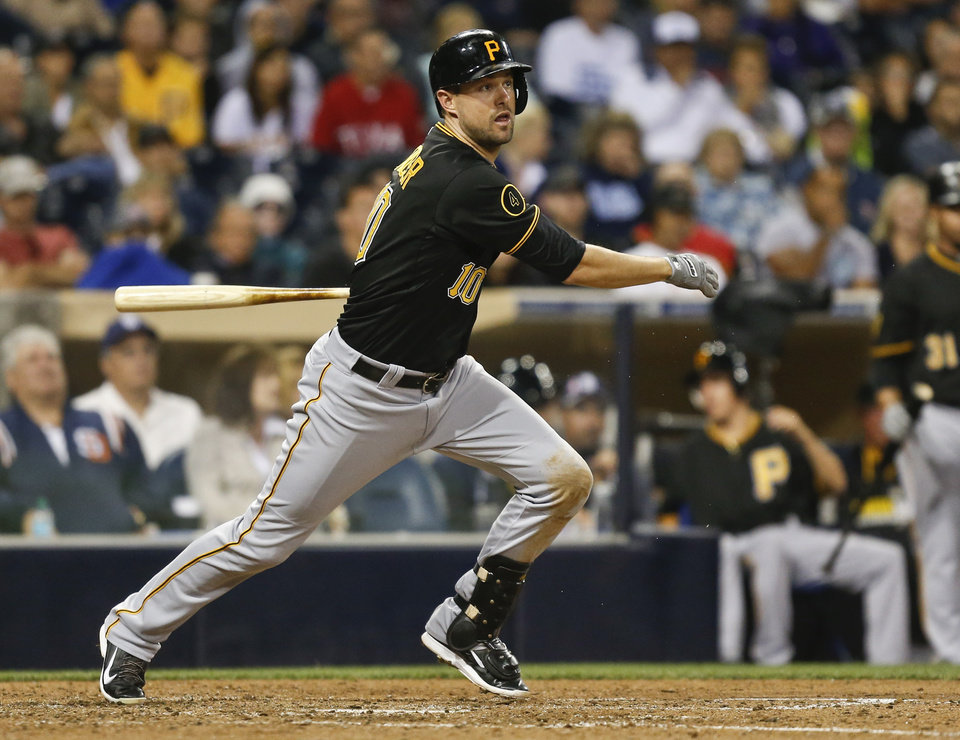 Photo - Pittsburgh Pirates' Jordy Mercer watches his line drive single to right during the seventh inning of a baseball game against the San Diego Padres, Monday, June 2, 2014, in San Diego. (AP Photo/Lenny Ignelzi)