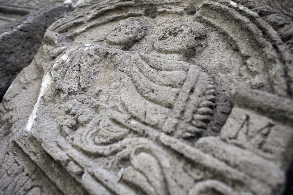 Photo -   This Friday, Oct. 5, 2012 photo shows mid relief on a Roman tombstone , found on the site of Ratiaria, an ancient Roman settlement located on the banks of the Danube, in the northwest corner of Bulgaria. Located on the crossroads of many ancient civilizations, Bulgarian scholars rank their country behind only Italy and Greece in Europe for the numbers of antiquities lying in its soil. But Bulgaria has been powerless to prevent the rape of its ancient sites, depriving the world of part of its cultural legacy and also costing this impoverished Balkan nation much-needed tourism revenue. (AP Photo/Valentina Petrova)