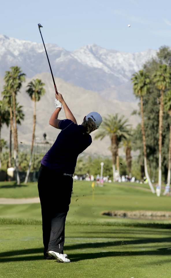 Photo - Stacy Lewis watches her tee shot on the 14th hole during the first round at the LPGA Kraft Nabisco Championship golf tournament Thursday, April 3, 2014 in Rancho Mirage, Calif. (AP Photo/Chris Carlson)