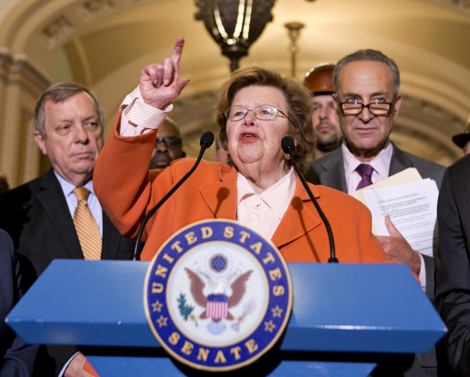 Photo - FILE - This Aug. 1, 2013 file photo shows Senate Appropriations Committee Chair  Sen. Barbara Mikulski, D-Md., flanked by Senate Majority Whip Richard Durbin of Ill., left, and Sen. Charles Schumer, D-N.Y., speaking on Capitol Hill in Washington.  Senate Republicans derailed a Democratic bill Wednesday curbing paycheck discrimination against women, an effort that even in defeat Democrats hoped would pay political dividends in this fall's congressional elections. Wednesday's vote was 53-44 to halt GOP tactics aimed at derailing the legislation, but that fell six short of the 60 Democrats needed to prevail. Mikulski stood up after the vote and said supporters were disappointed but that they would fight on. (AP Photo/J. Scott Applewhite, File)