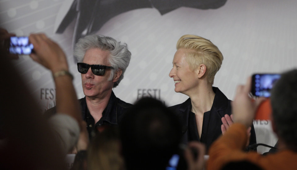 Photo - Director Jim Jarmusch, left, and actress Tilda Swinton are photographed prior to a press conference for the film Only Lovers Left Alive at the 66th international film festival, in Cannes, southern France, Saturday, May 25, 2013. (AP Photo/Virginia Mayo)