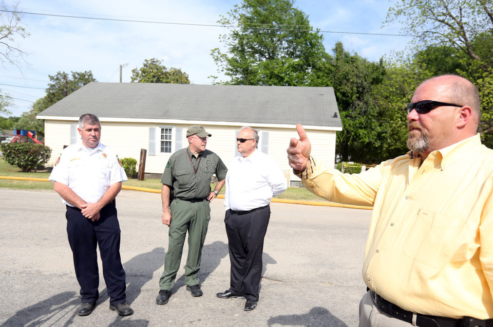 Photo - Hartsville Fire Chief Jeff Burr, Darlington County Sheriff Wayne Byrd, Coroner Todd Hardee and Public Information Officer Andy Locklair speak during a news conference following a fatal fire which claimed the lives of four children in Hartsville, S.C. on Wednesday, April 24, 2013.  (AP Photo/The Morning News, Rebecca J. Ducker)