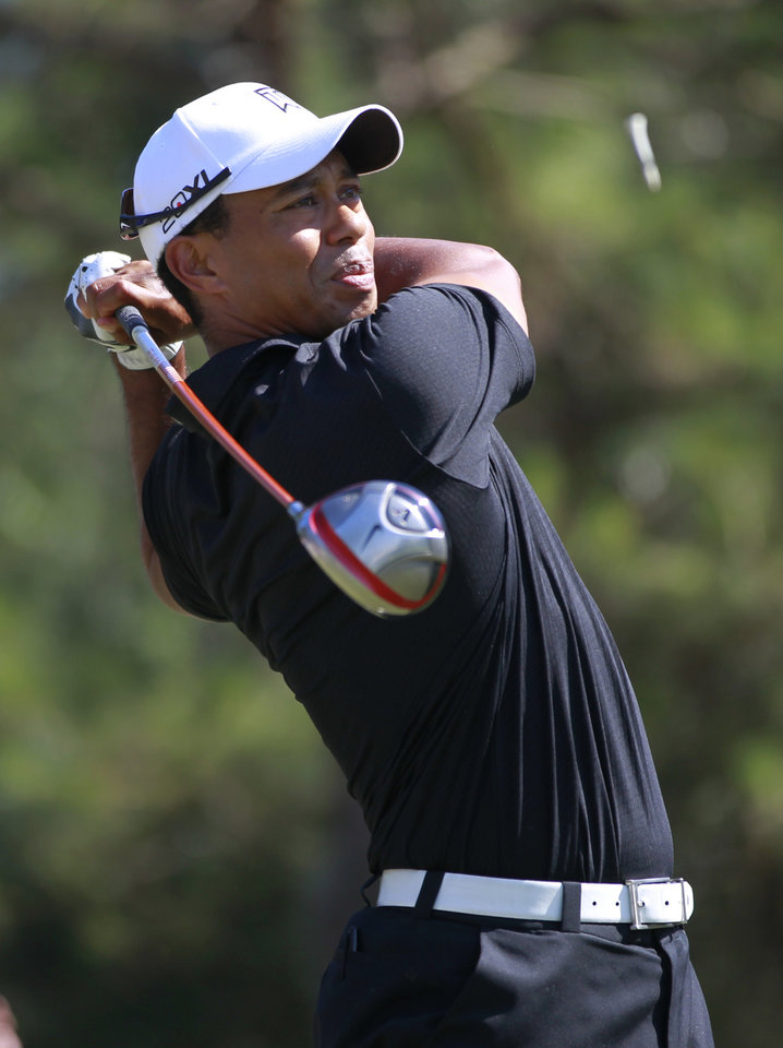 Photo -   Tiger Woods hits from the ninth tee during the second round of the Players Championship golf tournament at TPC Sawgrass, Friday, May 11, 2012, in Ponte Vedra Beach, Fla. (AP Photo/John Raoux)