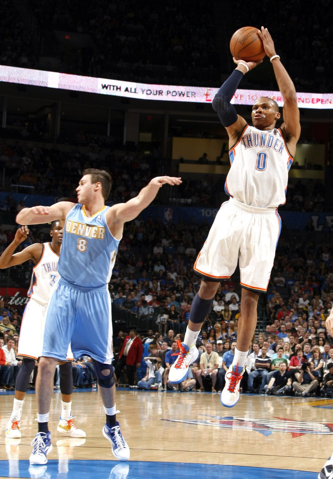 Photo - Oklahoma City's Russell Westbrook (0) shoots in front of Denver's Danilo Gallinari (8) during the NBA basketball game between the Oklahoma City Thunder and the Denver Nuggets, Friday, April 8, 2011, at the Oklahoma City Arena.. Photo by Sarah Phipps, The Oklahoman
