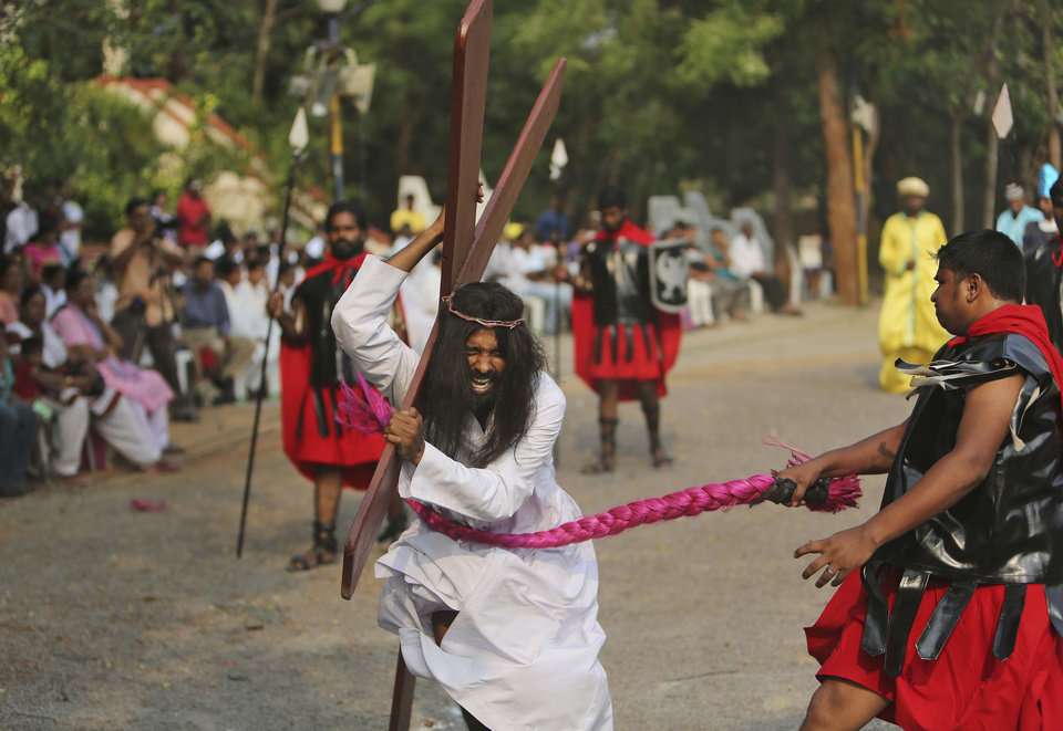 Photo - An Indian Christian devotee enacts the crucifixion of Jesus Christ to mark Good Friday at The Mount Carmel Church in Hyderabad, India, Friday, April 18, 2014. Christians all over the world are marking Good Friday, the day when Christ was crucified. (AP Photo/Mahesh Kumar A.)