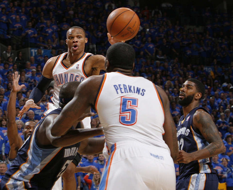 OKLAHOMA CITY ARENA / PLAYOFFS: Oklahoma City's Russell Westbrook (0) passes the ball near O.J. Mayo (32), right, of Memphis as Oklahoma City's Kendrick Perkins (5) is guarded by Zach Randolph (50) of Memphis in the first half during game 7 of the NBA basketball Western Conference semifinals between the Memphis Grizzlies and the Oklahoma City Thunder at the OKC Arena in Oklahoma City, Sunday, May 15, 2011. Photo by Nate Billings, The Oklahoman ORG XMIT: KOD