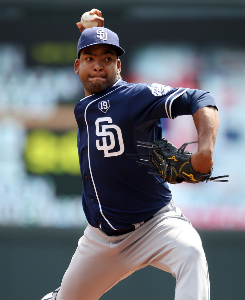 Photo - San Diego Padres pitcher Odrisamer Despaigne throws against the Minnesota Twins in the first inning of a baseball game, Wednesday, Aug. 6, 2014, in Minneapolis. (AP Photo/Jim Mone)