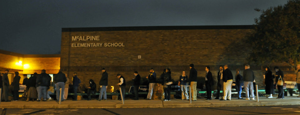 Photo -   Early voters line up outside McAlpine Elementary School to vote on Election Day, Tuesday, Nov. 6, 2012 in Charlotte, N.C. (AP Photo/The Charlotte Observer, Davie Hinshaw) LOCAL TV OUT (WSOC, WBTV, WCNC, WCCB); LOCAL PRINT OUT (CHARLOTTE BUSINESS JOURNAL, CREATIVE LOAFLING, CHARLOTTE WEEKLY, MECHLENBURG TIMES, CHARLOTTE MAGAZINE, CHARLOTTE PARENTS) LOCAL RADIO OUT (WBT)