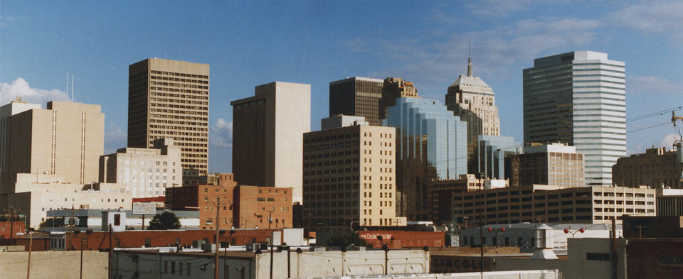 OKLAHOMA CITY / SKY LINE / OKLAHOMA:  Shown is the downtown skyline of Oklahoma City, which has nearly 450,000 people.  From Walker & NW 5th looking East.  Staff photo by Paul B. Southerland.  Photo dated 09/12/1994 and published 11/28/1994 in The Daily Oklahoman (C).