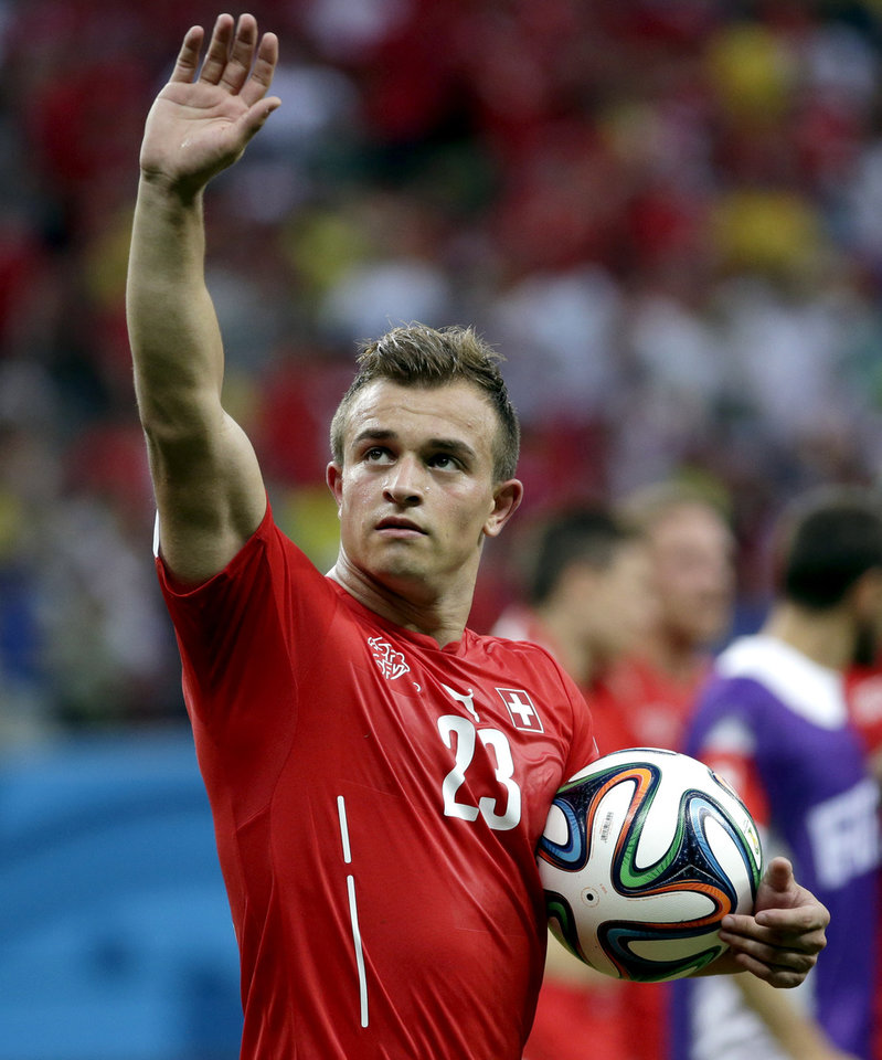 Photo - Switzerland's Xherdan Shaqiri salutes as he carries the ball after scoring a hat-trick during the group E World Cup soccer match between Honduras and Switzerland at the Arena da Amazonia in Manaus, Brazil, Wednesday, June 25, 2014. Switzerland won 3-0.(AP Photo/Felipe Dana)