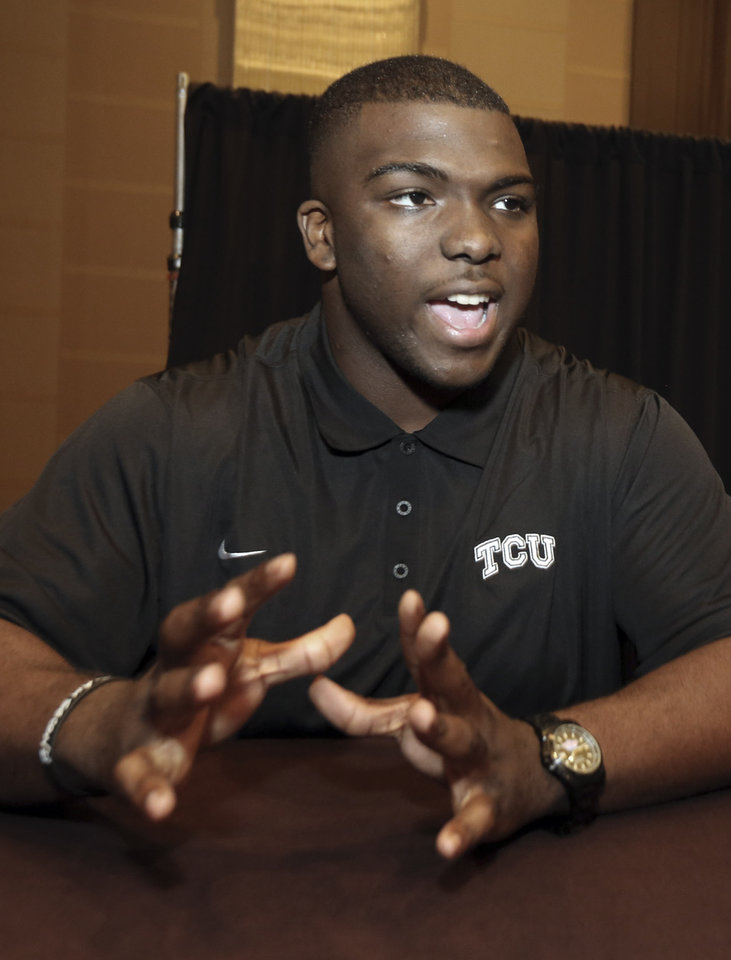 Photo - TCU defensive tackle Chucky Hunter speaks to reporters during the NCAA college Big 12 Conference Football Media Days in Dallas, Monday, July 21, 2014. (AP Photo/LM Otero)