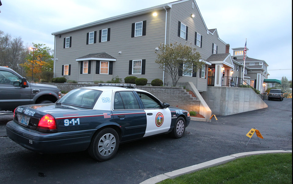 Photo - A North Attleborough police officer is stationed outside the Dyer-Lake Funeral Home in North Attleborough, Mass., where a vehicle believed to be carrying the body of Boston Marathon bombing suspect Tamerlan Tsarnaev arrived, Thursday, May 2, 2013. The body of Tsarnaev, who was the subject of a massive manhunt and died after a gunbattle with police, was claimed on Thursday. (AP Photo/Stew Milne)
