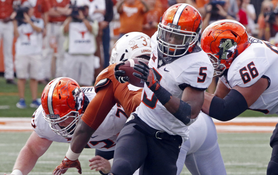 Photo -  Oklahoma State running back Justice Hill had his first fumble in 15 games on Saturday vs. Texas. [AP PHOTO]