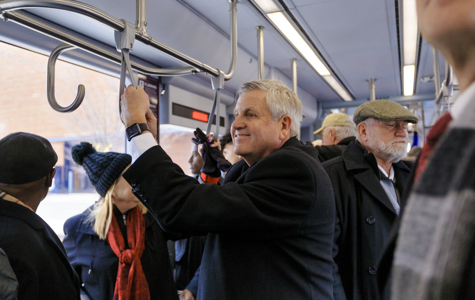 Photo - Former city manager for Oklahoma City Jim Couch takes a ride on the new streetcar during the grand opening celebration day of the Oklahoma City streetcar system in downtown Oklahoma City, Okla. on Friday, Dec. 14, 2018. Photo by Chris Landsberger, The Oklahoman