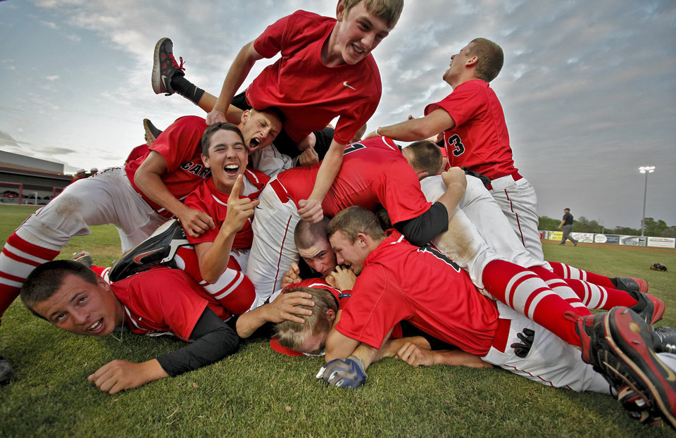 Verdigris celebrates after the 6-5 win over Metro Christian during the 3A State Championship baseball game at Edmond Memorial High School on Saturday,  May 12, 2012, in Edmond, Oklahoma. Photo by Chris Landsberger, The Oklahoman