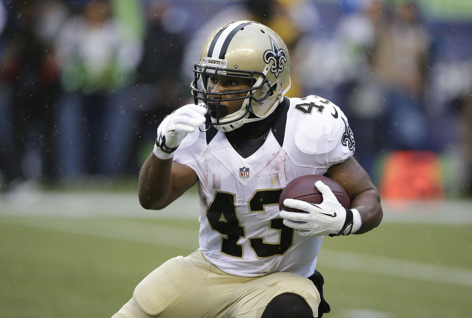 Photo - FILE - In this Jan. 11, 2014, file photo, New Orleans Saints running back Darren Sproles runs against the Seattle Seahawks during an NFC divisional playoff NFL football game in Seattle. The Philadelphia Eagles were eager to let the world know about the addition of the 30-year-old Sproles, who figures to be a threat as a receiver, runner, returner and in pass protection against blitzers. (AP Photo/Elaine Thompson, File)