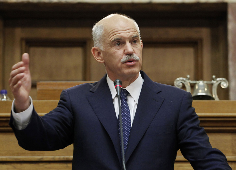 Greek Prime Minister George Papandreou addresses Socialist lawmakers members of parliament in Athens, in Athens, Thursday, Nov. 3, 2011. Greece\'s embattled prime minister says he has invited opposition conservatives to join talks on a major European debt deal, ignoring calls to hold an early general election.Papandreou on Thursday insisted he never would have put the question of whether Greece stays in the joint euro currency to a popular vote.(AP Photo/Petros Giannakouris) ORG XMIT: XPG103