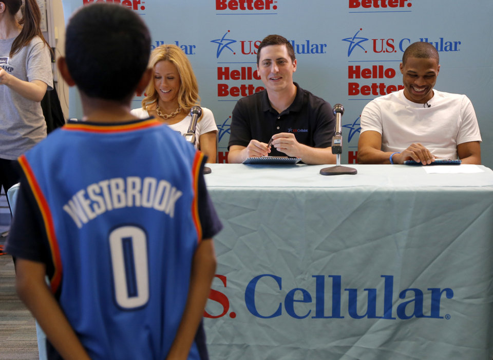 Photo -  Oklahoma City Thunder point guard Russell Westbrook, right, along with Thunder Girls manager Paige Carter and U.S. Cellular's Daniel Ferguson judge contestants during the Why Not Fashion contest. Photo by Bryan Terry, The Oklahoman   Bryan Terry -  THE OKLAHOMAN