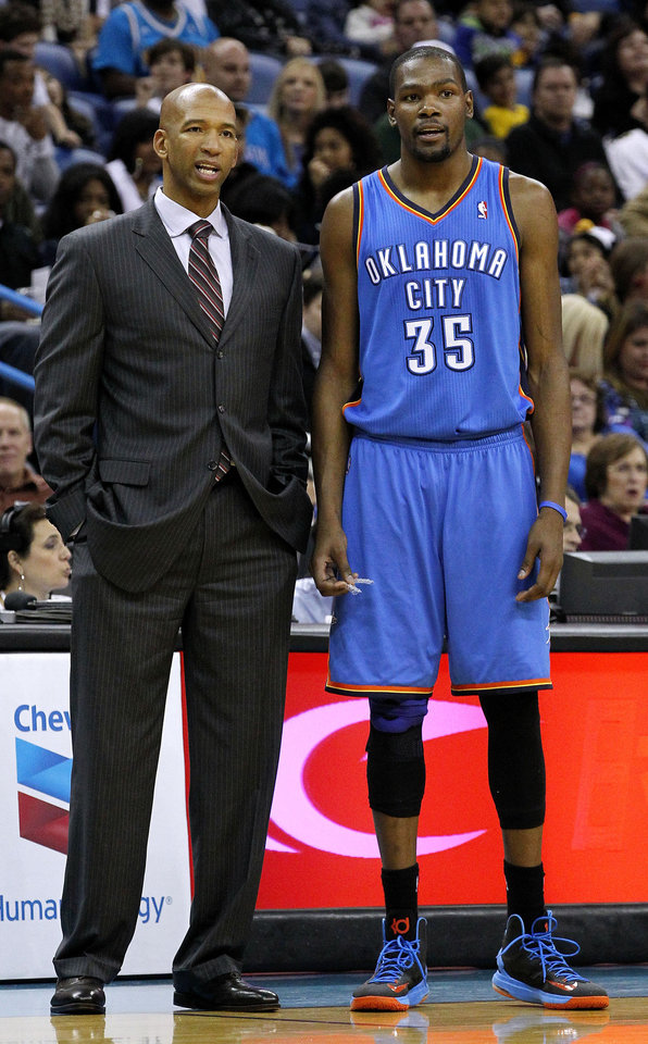 Photo - New Orleans Hornets head coach Monty Williams, left, talks to Oklahoma City Thunder small forward Kevin Durant (35) during the second half of an NBA basketball game in New Orleans, Friday, Nov. 16, 2012. The Thunder won 110-95. (AP Photo/Jonathan Bachman) ORG XMIT: LAJB120