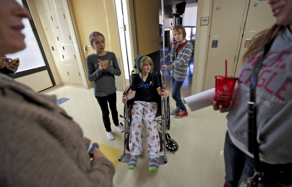 Liz Smith, Ambri Tygard and Savanna Gable, from left, wait for their mothers to finish speaking after the three finished speaking to the media about their injuries and experience of being trapped under an elevator at Classen School of Advance Studies during a press conference at the OU Medical Center Children's Hospital on Thursday, Nov. 17, 2011. in Oklahoma City, Okla..  Photo by Chris Landsberger, The Oklahoman