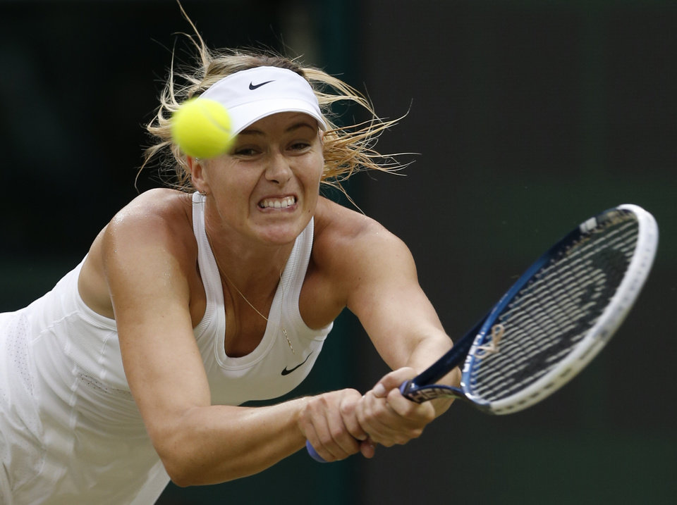 Photo - Maria Sharapova of Russia plays a return to Alison Riske of U.S. during their women's singles match at the All England Lawn Tennis Championships in Wimbledon, London, Saturday, June 28, 2014. (AP Photo/Ben Curtis)